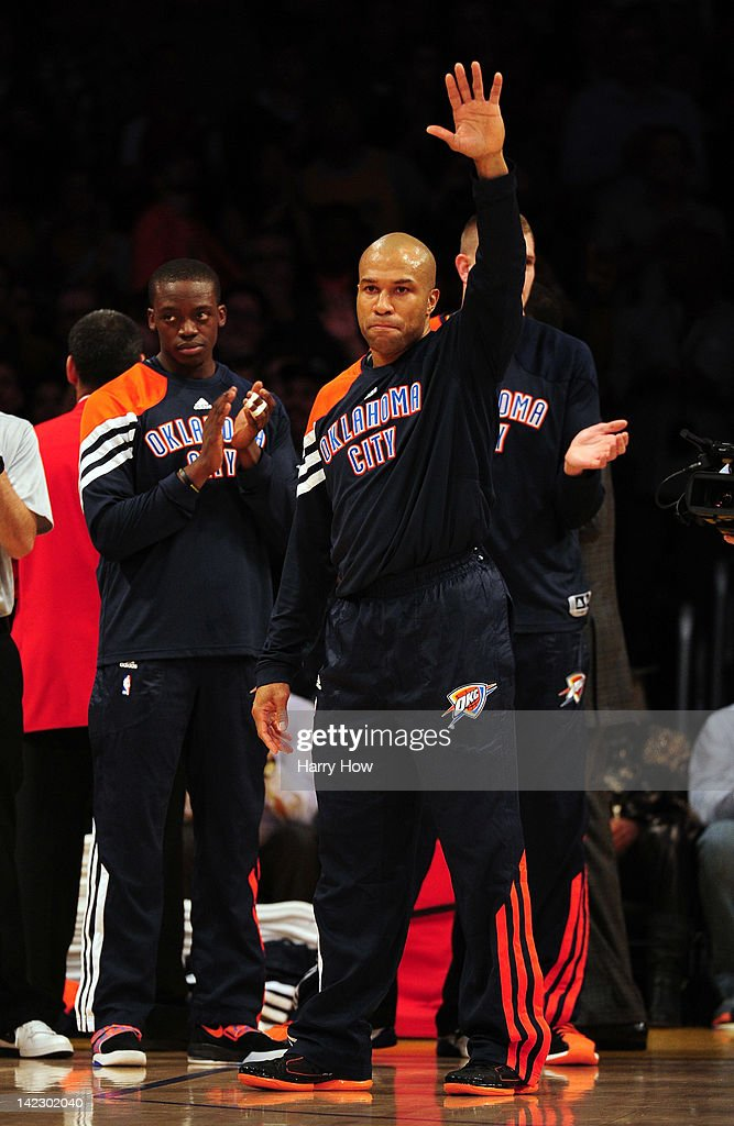<a gi-track='captionPersonalityLinkClicked' href=/galleries/search?phrase=Derek+Fisher&family=editorial&specificpeople=201724 ng-click='$event.stopPropagation()'>Derek Fisher</a> #37 of the Oklahoma City Thunder waves to fans as he receives applause returning to play against the Los Angeles Lakers at Staples Center on March 29, 2012 in Los Angeles, California.