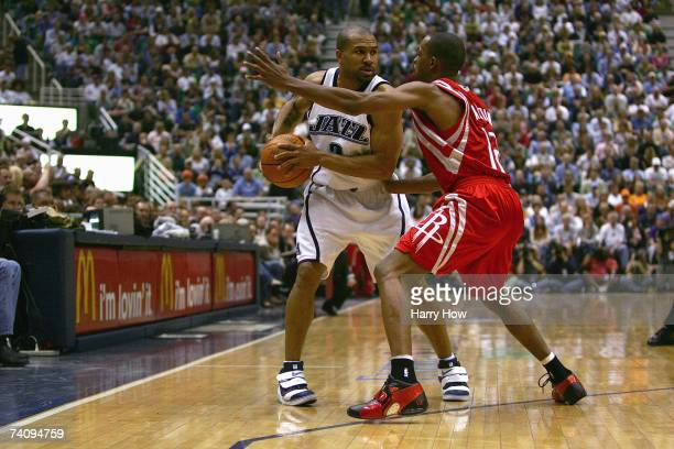 Derek Fisher of the Utah Jazz is defended by Rafer Alston of the Houston Rockets during Game Six of the Western Conference Quarterfinals during the...