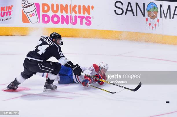 Derek Forbort of the Los Angeles Kings battles for the puck against Charles Hudon of the Montreal Canadiens at STAPLES Center on October 18 2017 in...