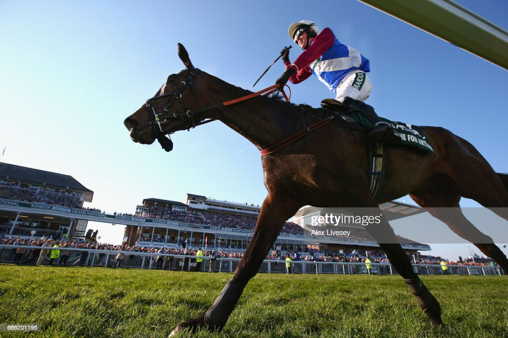 Derek Fox celebrates as he crosses the finish line to win the 2017 Randox Health Grand National on One For Arthur at Aintree Racecourse on April 8, 2017 in Liverpool, England.