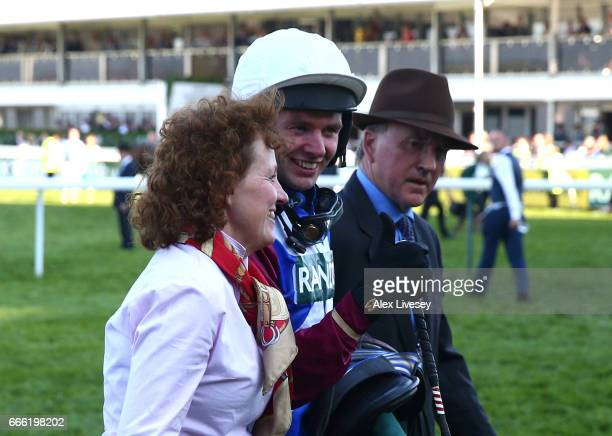 Derek Fox jockey of One For Arthur and trainer Lucinda Russell celebrate winning the 2017 Randox Heath Grand National at Aintree Racecourse on April...