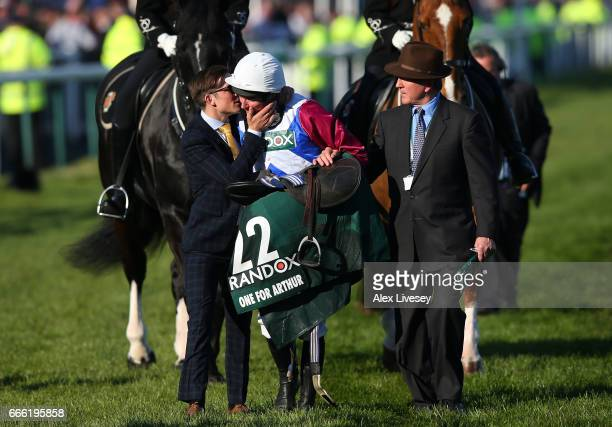 Derek Fox jockey of One For Arthur celebrates winning the 2017 Randox Heath Grand National at Aintree Racecourse on April 8 2017 in Liverpool England