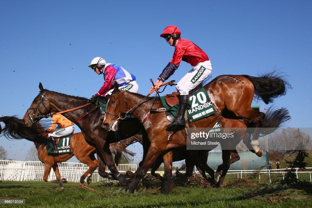 Derek Fox (L) on One For Arthur clears Canal Turn alongside Charlie Deutsch (R) on Houblon Des Obeaux during day three of the Randox Health Grand National meeting at Aintree Racecourse on April 8, 2017 in Liverpool, England.