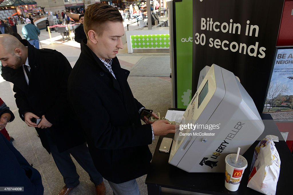 Derek Gilroy purchases some Bitcoin from a newly installed Bitcoin ATM at South Station February 20, 2014 in Boston, Massachusetts. The ATM was placed by Liberty Teller to help inform people about the digital currency, which can be bought and sold anonymously, and can be used at a number of online retailers in place of cash or credit cards.