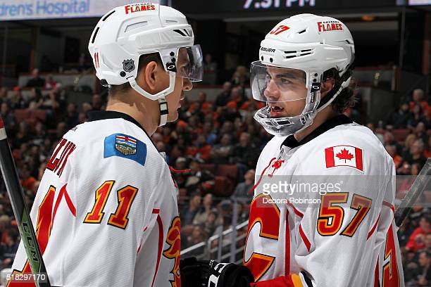 Derek Grant and Mikael Backlund of the Calgary Flames talk before resuming play during the game against the Anaheim Ducks on March 30 2016 at Honda...