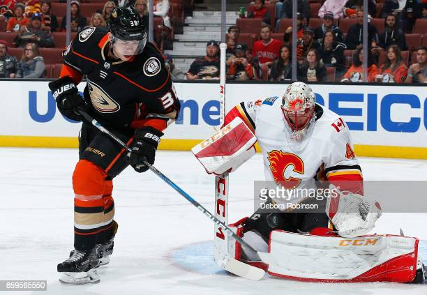 Derek Grant of the Anaheim Ducks battles in front of the net against Mike Smith of the Calgary Flames during the game on October 9 2017 at Honda...