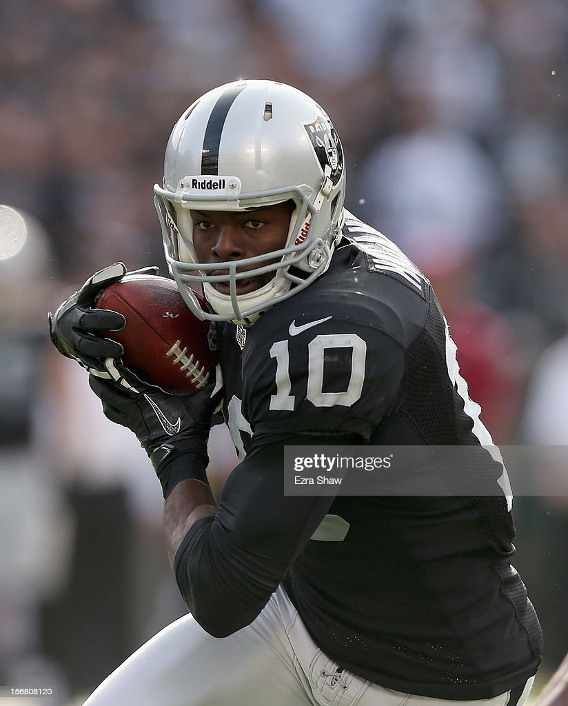 <a gi-track='captionPersonalityLinkClicked' href=/galleries/search?phrase=Derek+Hagan&family=editorial&specificpeople=266020 ng-click='$event.stopPropagation()'>Derek Hagan</a> #10 of the Oakland Raiders in action against the New Orleans Saints at O.co Coliseum on November 18, 2012 in Oakland, California.