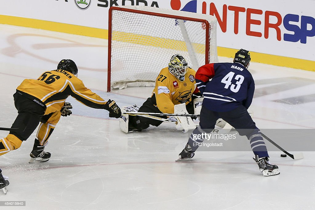 Derek Hahn (#43 ERC Ingolstadt) takes a shot on goal at Goalie Markkanen Jussi #27 yellow SAI - Lappalainen Lasse #56 yellow SAI - Game 2 of 6 during the Champions Hockey League group stage game between ERC Ingolstadt and SaiPa Lappeenranta on August 23, 2014 in Ingolstadt, Germany.