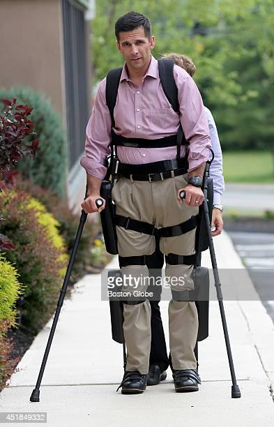 Derek Herrera a paraplegic US Marine stands upright using ReWalk an exoskeleton using motors and braces for upright walking