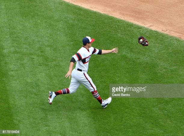 Derek Holland of the Chicago White Sox throws his glove with the ball in it to Jose Abreu of the Chicago White Sox to throw out Robinson Cano of the...