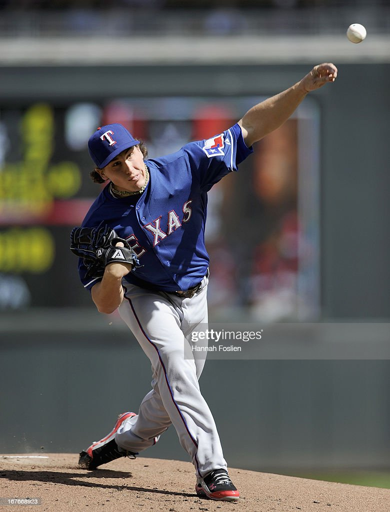 Derek Holland #45 of the Texas Rangers delivers a pitch against the Minnesota Twins during the first inning of the game on April 27, 2013 at Target Field in Minneapolis, Minnesota.