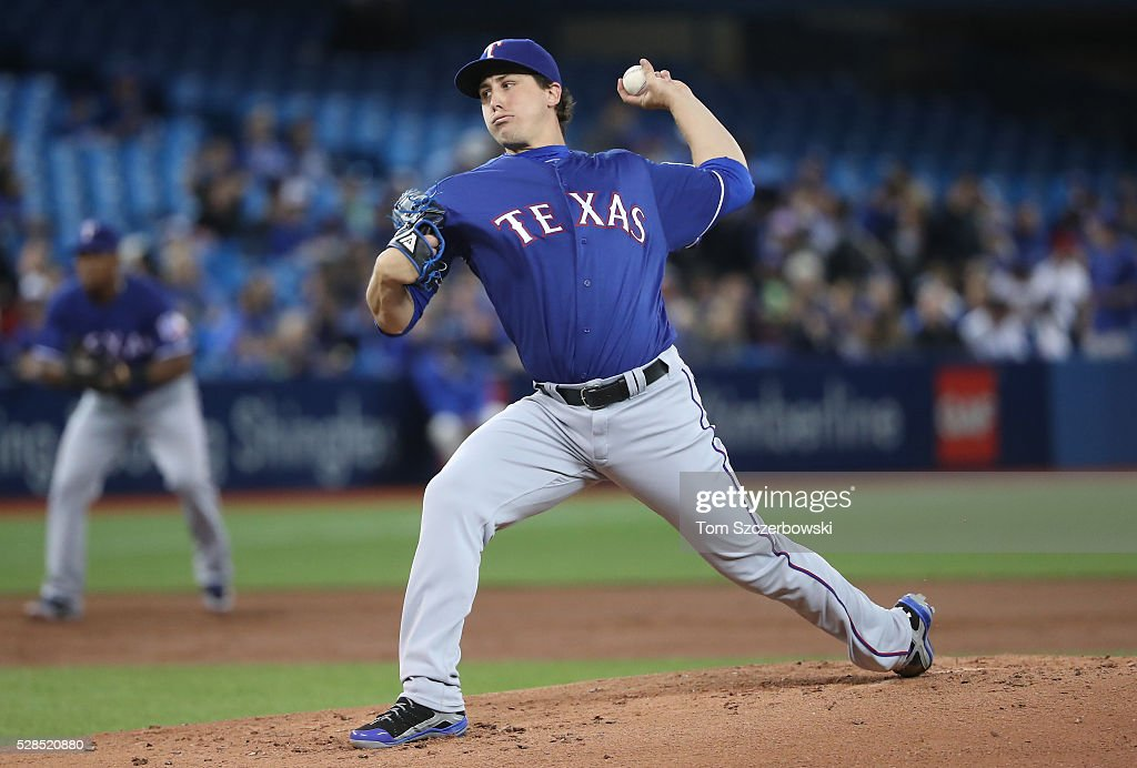 Derek Holland #45 of the Texas Rangers delivers a pitch in the first inning during MLB game action against the Toronto Blue Jays on May 5, 2016 at Rogers Centre in Toronto, Ontario, Canada.