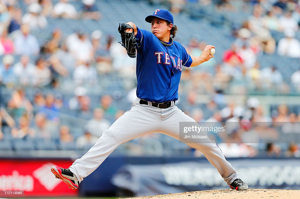 Derek Holland #45 of the Texas Rangers in action against the New York Yankees at Yankee Stadium on June 27, 2013 in the Bronx borough of New York City. The Rangers defeated the Yankees 2-0.