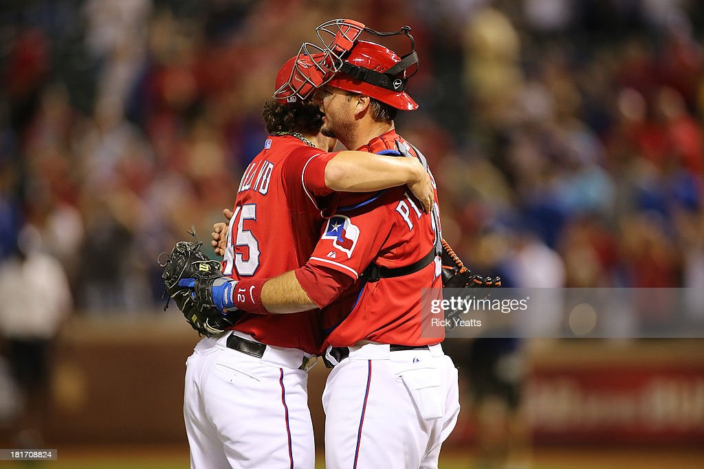 Derek Holland #45 of the Texas Rangers is congratulated by <a gi-track='captionPersonalityLinkClicked' href=/galleries/search?phrase=A.J.+Pierzynski&family=editorial&specificpeople=204486 ng-click='$event.stopPropagation()'>A.J. Pierzynski</a> #12 for pitching a shutout against the Houston Astros at Rangers Ballpark in Arlington on September 23, 2013 in Arlington, Texas.