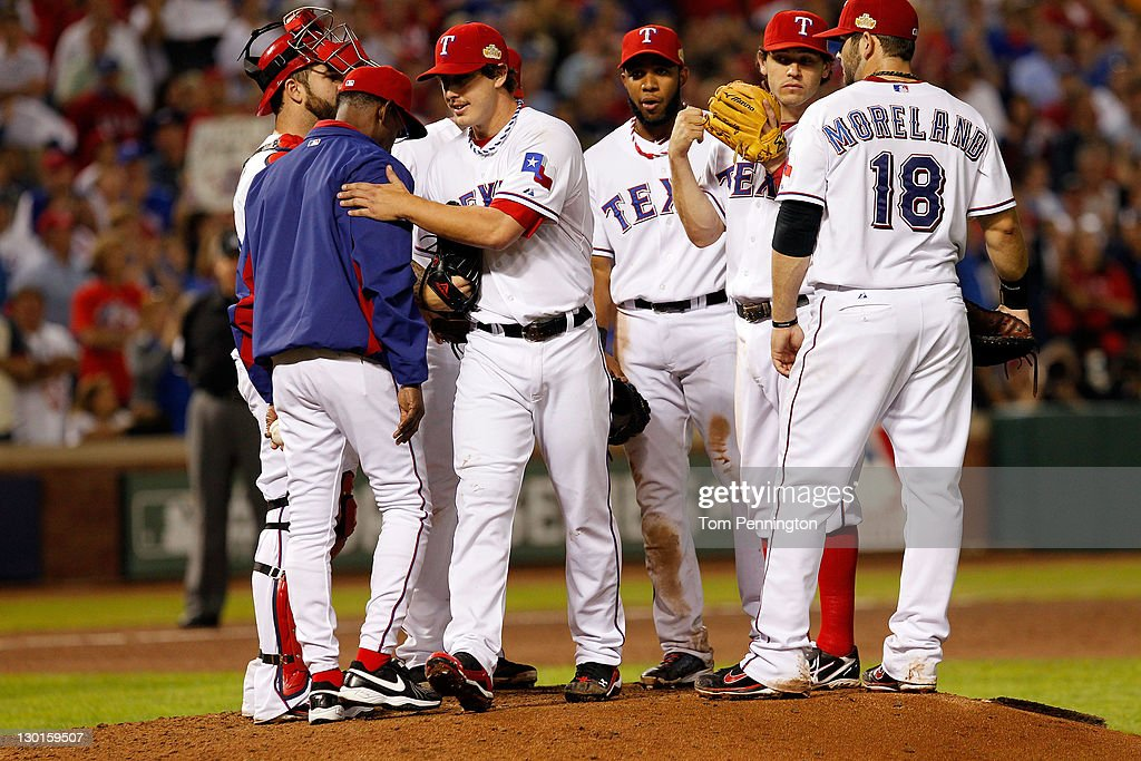 Derek Holland #45 of the Texas Rangers is removed by manager <a gi-track='captionPersonalityLinkClicked' href=/galleries/search?phrase=Ron+Washington&family=editorial&specificpeople=225012 ng-click='$event.stopPropagation()'>Ron Washington</a> in the ninth inning during Game Four of the MLB World Series against the St. Louis Cardinals at Rangers Ballpark in Arlington on October 23, 2011 in Arlington, Texas.