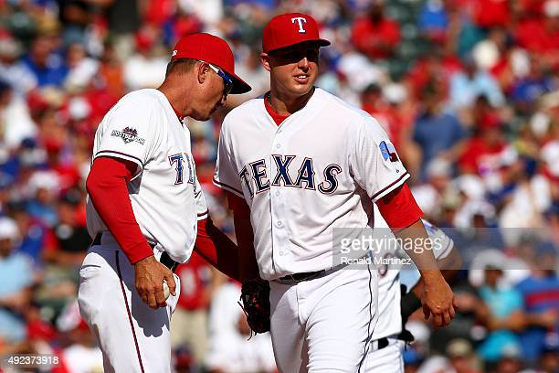 Derek Holland of the Texas Rangers is taken out of the game by manager Jeff Banister in the third inning against the Toronto Blue Jays in game four...