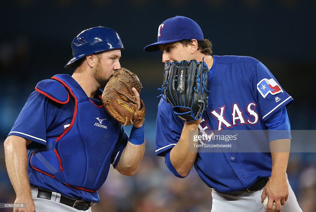 <a gi-track='captionPersonalityLinkClicked' href=/galleries/search?phrase=Derek+Holland+-+Baseballspieler&family=editorial&specificpeople=8003703 ng-click='$event.stopPropagation()'>Derek Holland</a> #45 of the Texas Rangers is visited on the mound by <a gi-track='captionPersonalityLinkClicked' href=/galleries/search?phrase=Bryan+Holaday&family=editorial&specificpeople=7511226 ng-click='$event.stopPropagation()'>Bryan Holaday</a> #8 in the first inning during MLB game action against the Toronto Blue Jays on May 5, 2016 at Rogers Centre in Toronto, Ontario, Canada.