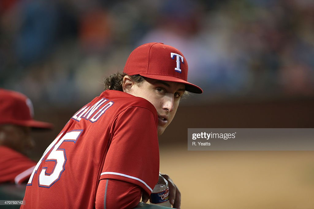 Derek Holland #45 of the Texas Rangers looks o during the fifth inning against the Houston Astros at Globe Life Park in Arlington on April 11, 2015 in Arlington, Texas.