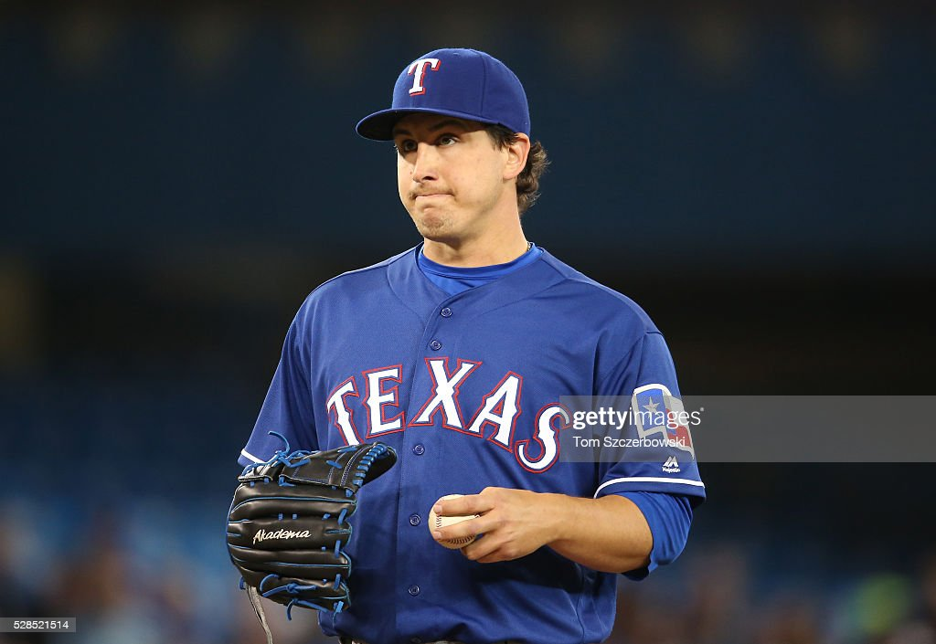 <a gi-track='captionPersonalityLinkClicked' href=/galleries/search?phrase=Derek+Holland+-+Baseball+Player&family=editorial&specificpeople=8003703 ng-click='$event.stopPropagation()'>Derek Holland</a> #45 of the Texas Rangers looks on after giving up a run in the first inning during MLB game action against the Toronto Blue Jays on May 5, 2016 at Rogers Centre in Toronto, Ontario, Canada.