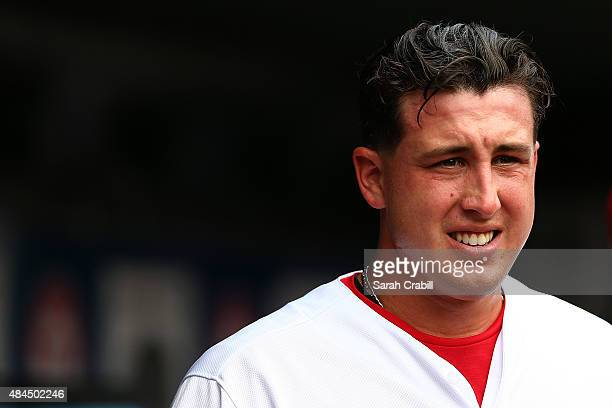 Derek Holland of the Texas Rangers looks on from the dugout during a game against the Seattle Mariners at Globe Life Park in Arlington on August 19...