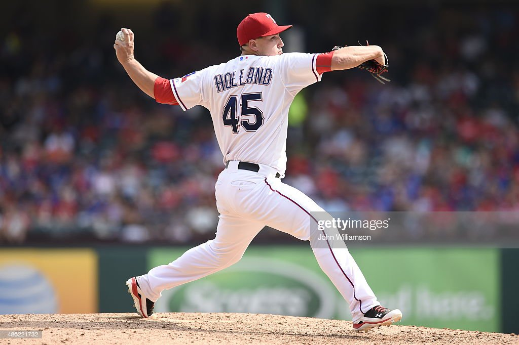<a gi-track='captionPersonalityLinkClicked' href=/galleries/search?phrase=Derek+Holland+-+Baseball+Player&family=editorial&specificpeople=8003703 ng-click='$event.stopPropagation()'>Derek Holland</a> #45 of the Texas Rangers pitches against the Baltimore Orioles at Globe Life Park in Arlington on August 30, 2015 in Arlington, Texas. The Texas Rangers defeated the Baltimore Orioles 6-0.