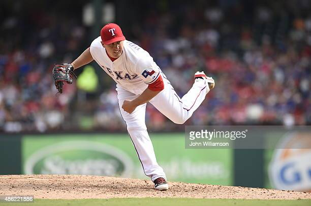 Derek Holland of the Texas Rangers pitches against the Baltimore Orioles at Globe Life Park in Arlington on August 30 2015 in Arlington Texas The...