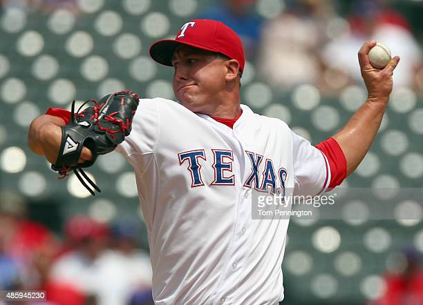 Derek Holland of the Texas Rangers pitches against the Baltimore Orioles in the top of the first inning at Globe Life Park in Arlington on August 30...