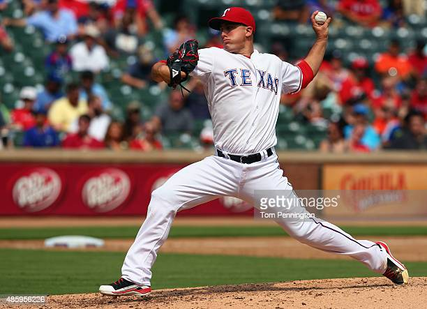 Derek Holland of the Texas Rangers pitches against the Baltimore Orioles in the top of the fifth inning at Globe Life Park in Arlington on August 30...