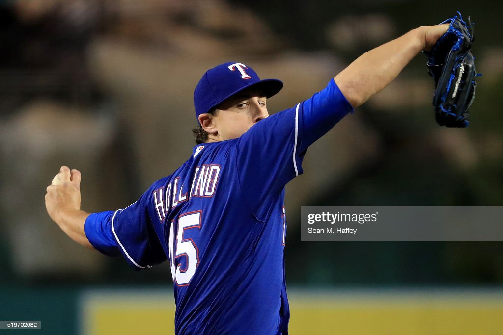 <a gi-track='captionPersonalityLinkClicked' href=/galleries/search?phrase=Derek+Holland+-+Baseball+Player&family=editorial&specificpeople=8003703 ng-click='$event.stopPropagation()'>Derek Holland</a> #45 of the Texas Rangers pitches against the Los Angeles Angels of Anaheim during the first inning of a baseball game against the Texas Rangers at Angel Stadium of Anaheim on April 7, 2016 in Anaheim, California.