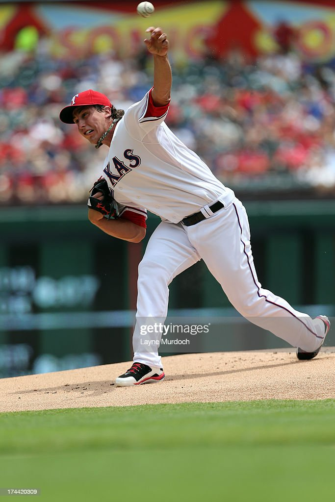 Derek Holland #45 of the Texas Rangers pitches against the New York Yankees on July 25, 2013 at the Rangers Ballpark in Arlington in Arlington, Texas.