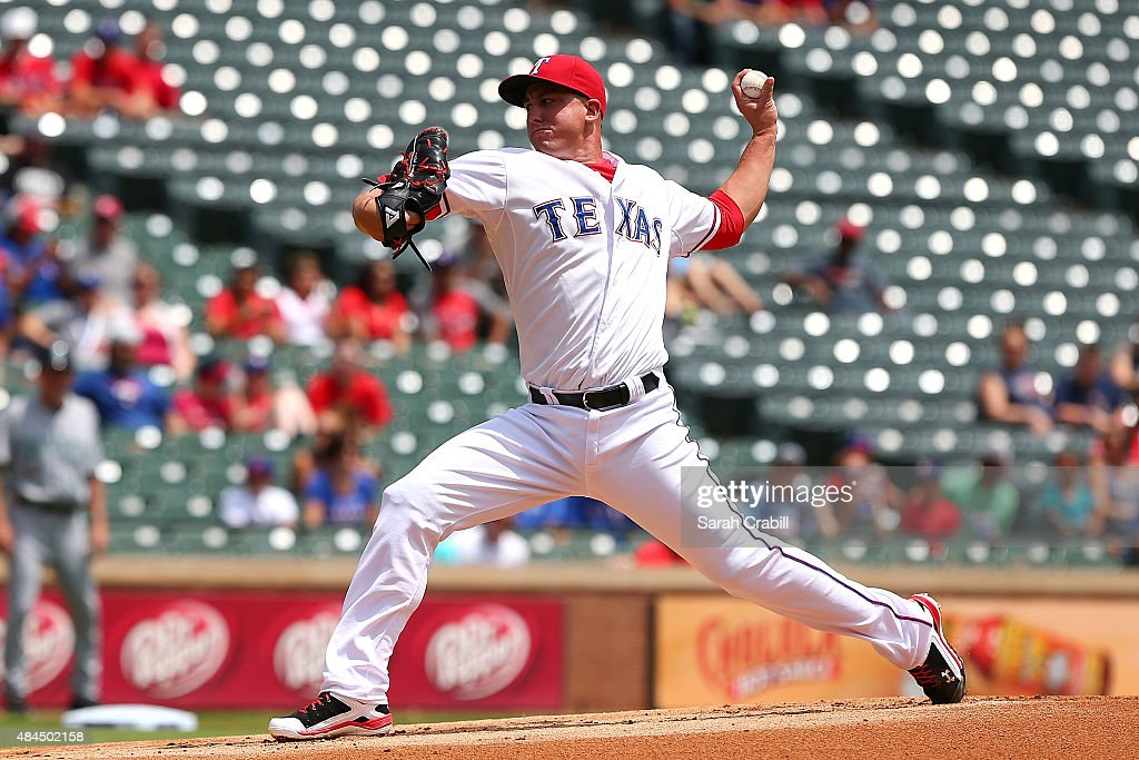 Derek Holland #45 of the Texas Rangers pitches in the first inning during a game against the Seattle Mariners at Globe Life Park in Arlington on August 19, 2015 in Arlington, Texas.