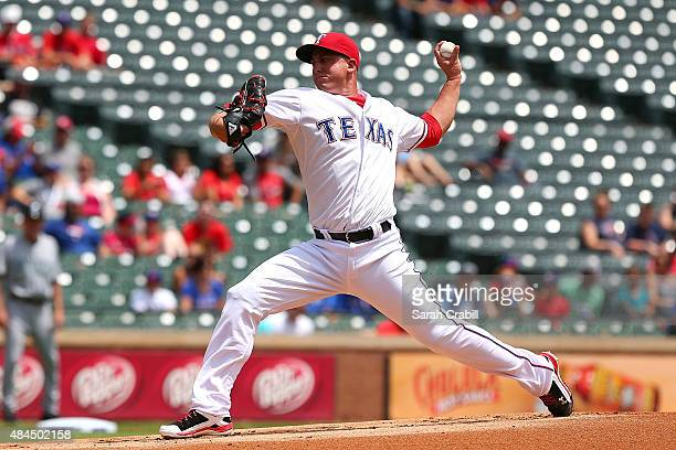 Derek Holland of the Texas Rangers pitches in the first inning during a game against the Seattle Mariners at Globe Life Park in Arlington on August...
