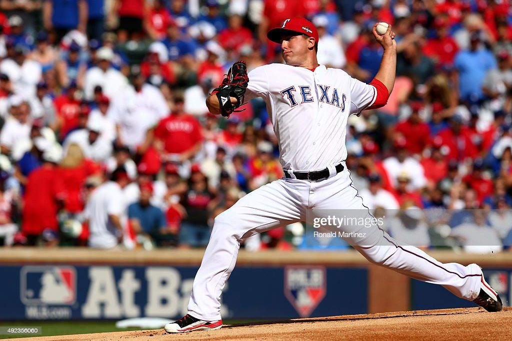 Derek Holland #45 of the Texas Rangers pitches in the first inning against the Toronto Blue Jays in game four of the American League Division Series at Globe Life Park in Arlington on October 12, 2015 in Arlington, Texas.