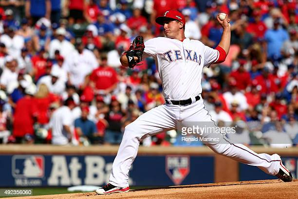 Derek Holland of the Texas Rangers pitches in the first inning against the Toronto Blue Jays in game four of the American League Division Series at...