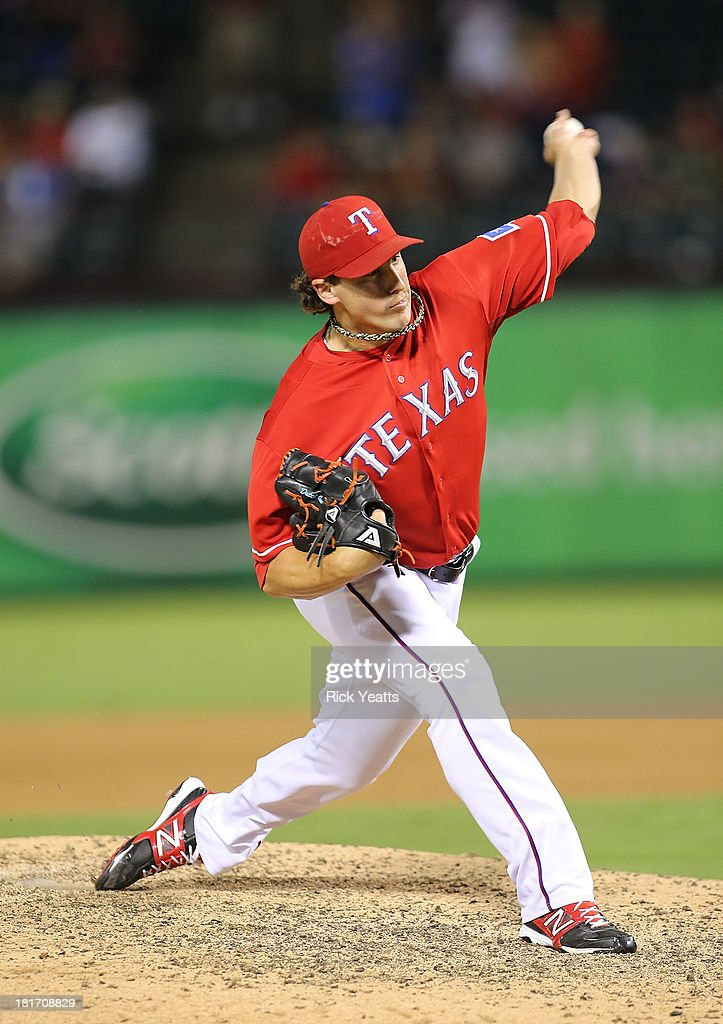 Derek Holland #45 of the Texas Rangers pitches in the ninth inning closing out the game with a shutout against the Houston Astros at Rangers Ballpark in Arlington on September 23, 2013 in Arlington, Texas.