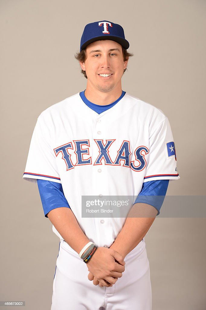 Derek Holland #45 of the Texas Rangers poses during Photo Day on Monday, March 2, 2015 at Surprise Stadium in Surprise, Arizona.