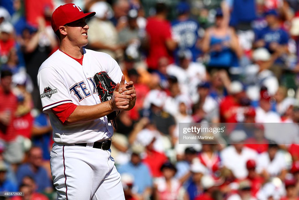 Derek Holland #45 of the Texas Rangers reacts in the first inning against the Toronto Blue Jays in game four of the American League Division Series at Globe Life Park in Arlington on October 12, 2015 in Arlington, Texas.
