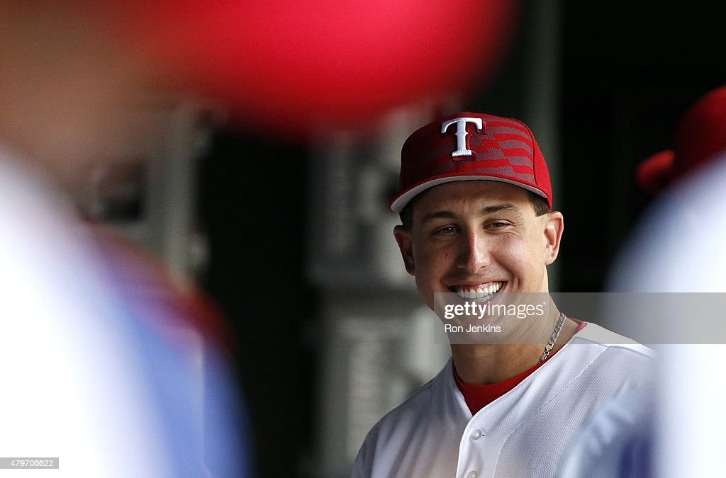 Derek Holland #45 of the Texas Rangers smiles before a baseball game against the Los Angeles Angels at Globe Life Park on July 4, 2015 in Arlington, Texas.
