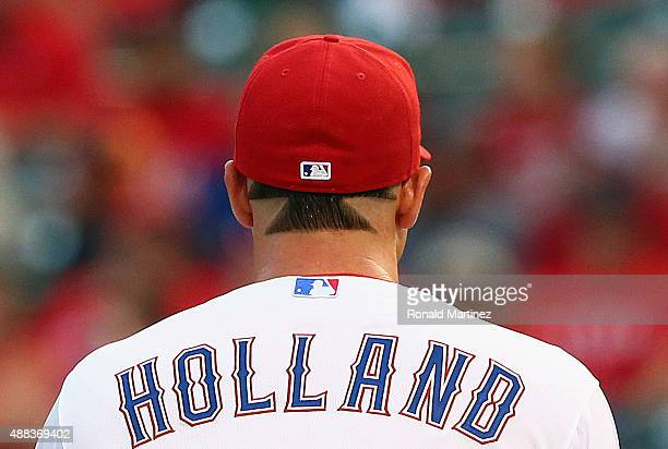 Derek Holland of the Texas Rangers throws against the Houston Astros in the first inning at Globe Life Park in Arlington on September 15 2015 in...