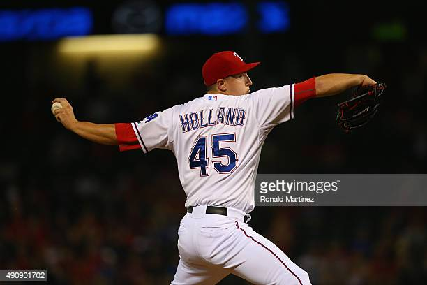 Derek Holland of the Texas Rangers throws against the Los Angeles Angels in the second inning at Globe Life Park in Arlington on October 1 2015 in...