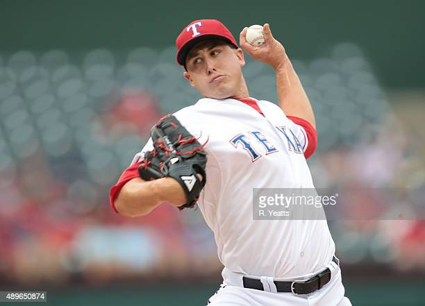 Derek Holland of the Texas Rangers throws in the first inning against the Seattle Mariners at Global Life Park in Arlington on September 20 2015 in...