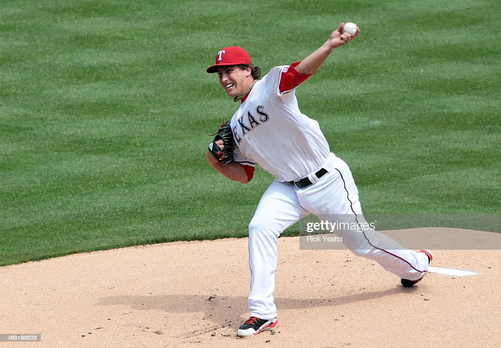 Derek Holland #45 of the Texas Rangers throws in the first inning of the home opener against Houston Astros at Globe Life Park in Arlington on April 10, 2015 in Arlington, Texas.