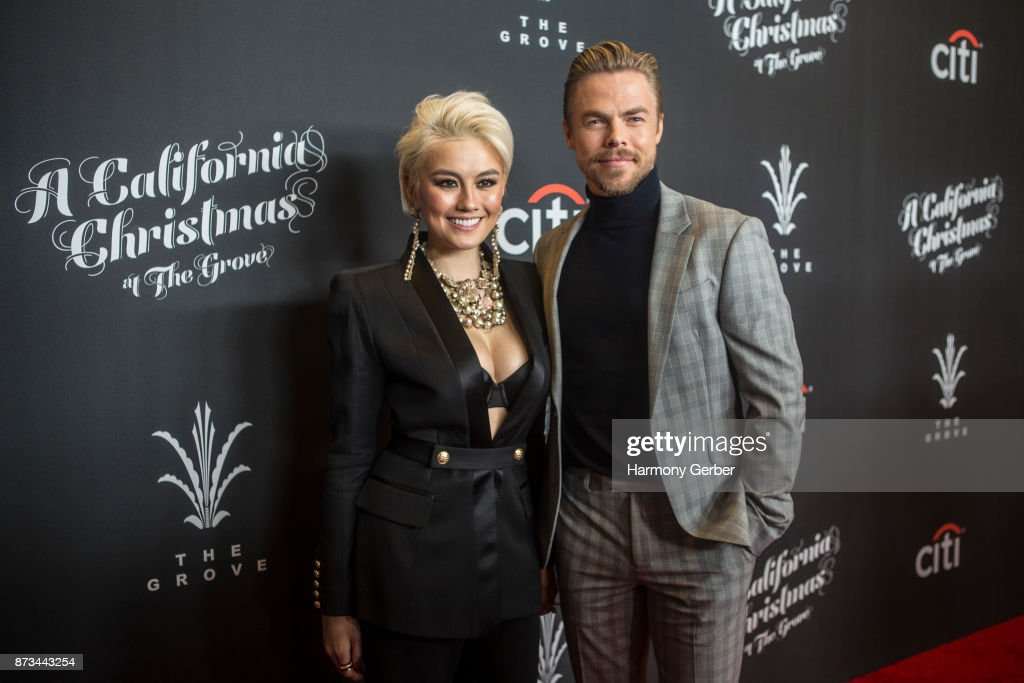 Derek Hough and Agnez Mo attend the California Christmas at The Grove on November 12, 2017 in Los Angeles, California.