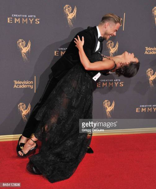 Derek Hough and Hayley Erbert arrive at the 2017 Creative Arts Emmy Awards Day 1 at Microsoft Theater on September 9 2017 in Los Angeles California