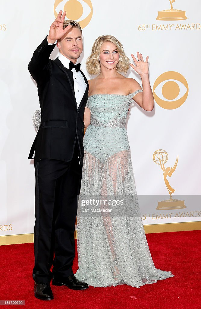 Derek Hough and Julianne Hough arrive at the 65th Annual Primetime Emmy Awards at Nokia Theatre L.A. Live on September 22, 2013 in Los Angeles, California.