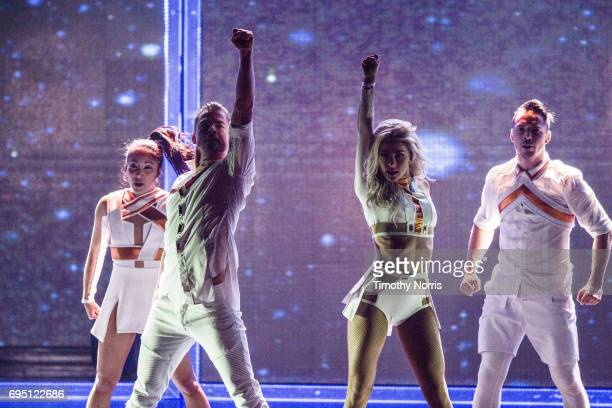 Derek Hough and Julianne Hough perform during Julianne and Derek Hough Move Beyond Live at Microsoft Theater on June 11 2017 in Los Angeles California