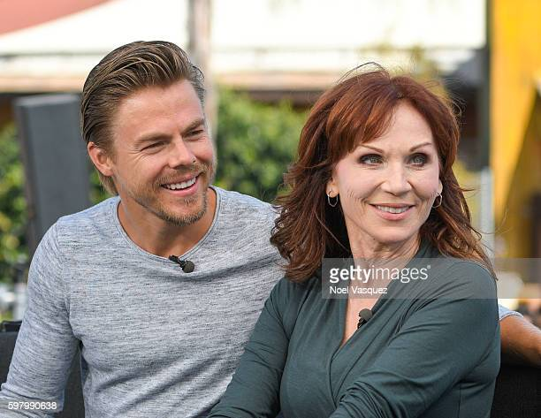 Derek Hough and Marilu Henner visit 'Extra' at Universal Studios Hollywood on August 30 2016 in Universal City California