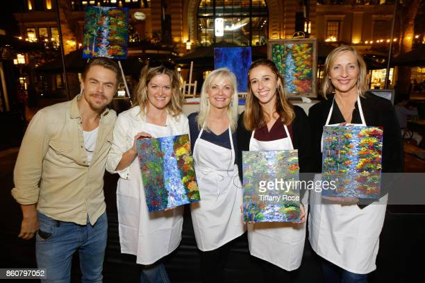 Derek Hough and mother Marriann Nelson pose with guests at the Paint Sip Help event to Benefit Children's Hospital Los Angeles hosted at The Grove on...