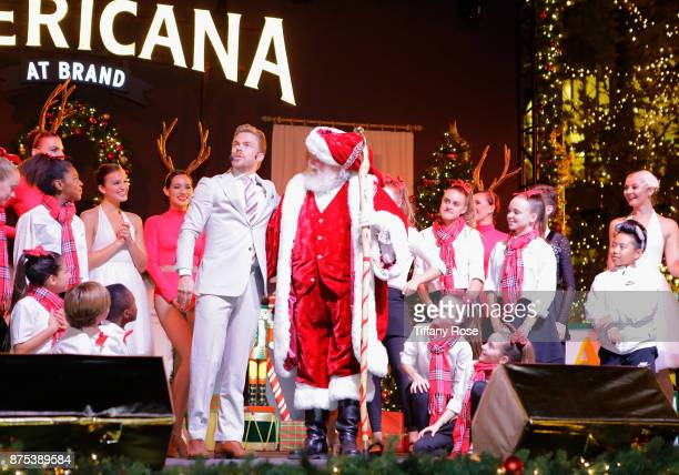 Derek Hough and performers onstage at Derek Hough Hosts The Americana at Brand Tree Lighting Presented By BMW on November 16 in Glendale California...