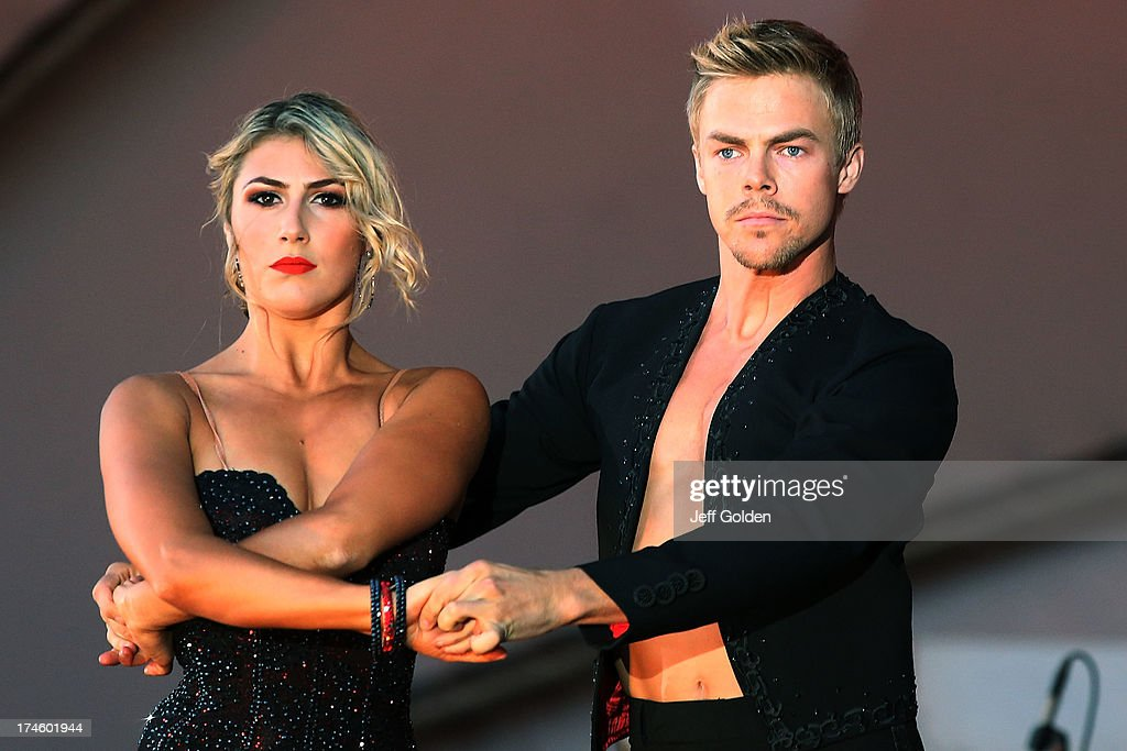 <a gi-track='captionPersonalityLinkClicked' href=/galleries/search?phrase=Derek+Hough&family=editorial&specificpeople=4532214 ng-click='$event.stopPropagation()'>Derek Hough</a> dances with partner Emma Slater during the California Philharmonic Festival on the Green at Santa Anita Race Track on July 27, 2013 in Arcadia, California.